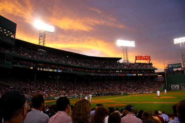 The sun sets behind the Green Monster.  © Kate Vista, 2015